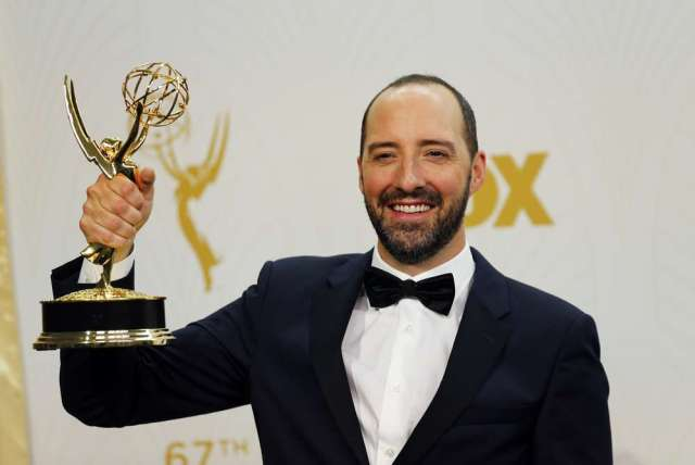"Actor Tony Hale holds the award for Outstanding Supporting Actor In A Comedy Series for the HBO series ""Veep"" backstage during the 67th Primetime Emmy Awards in Los Angeles, California September 20, 2015. REUTERS/Mike Blake - RTS22RM"
