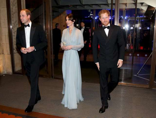 "Prince William, Duke of Cambridge (L), Catherine, Duchess of Cambridge (C) and Prince Harry (R) attend The Cinema and Television Benevolent Fund's Royal Film Performance 2015 of the new James Bond 007 film ""Spectre"" at Royal Albert Hall on October 26, 2015 in London, England. REUTERS/Chris Jackson/Pool - RTX1TCOT"