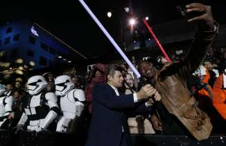 """Actor Andy Serkis poses with fans as he arrives at the premiere of """"Star Wars: The Force Awakens"""" in Hollywood"""