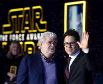 """Star Wars creator George Lucas (L) and director JJ Abrahms pose at the premiere of """"Star Wars: The Force Awakens"""" in Hollywood, California"""