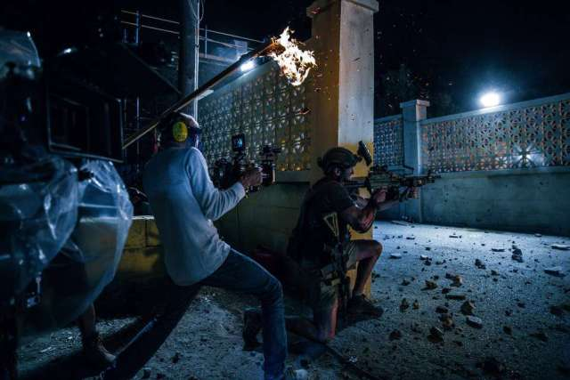 Left to right: Director Michael Bay and Pablo Schreiber on the set of 13 Hours: The Secret Soldiers of Benghazi from Paramount Pictures and 3 Arts Entertainment / Bay Films in theatres January 15, 2016.