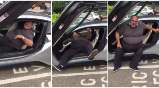 Para este homem sair do seu BMW i8 é uma verdadeira luta