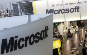 Visitors look around at the Microsoft stand at the world's largest computer trade fair CeBit