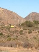 Poles between hills