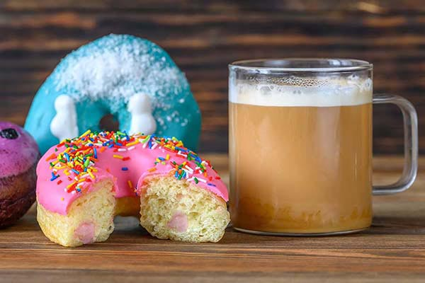 Donuts with a cup of coffee close-up