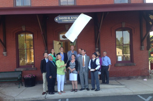 Mayor, Boro Administrator, Council members and members of the Knights family unveil new sign at the Hopewell Boro train station