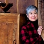 Mira Nakashima with wood for legendary furniture from Internet