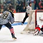 Pennington Goalie Bill Bernal blocks a shot Mike Schwartz