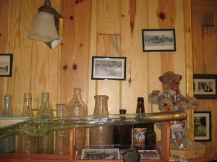 Old bottles (30's 40's) and postcards (1900-1940) make a nice display on top of a bookcase. Most of these postcards are local to Greenwood Lake. Most of the bottles were found in excavations in the Greenwood Lake area. The kuchina is not old and is from Arizona.