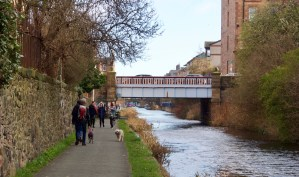 View of Union Canal towpath with pedestrians and dogs