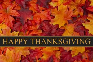 banner-for-giving-thanks-with-fall-leaves-and-the-words-happy-thanksgiving