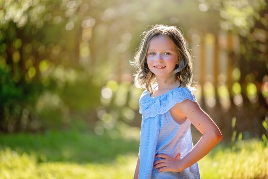 young girl wearing blue blouse for family pictures in great bridge, chesapeake, va