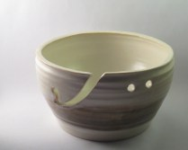 Matte-finished yarn bowl in soft cream and sand colours, featuring custom cutout to catch yarn and holes to lock-in needles for storage (SOLD)