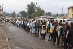 A common scene of Addis Ababa residents lining for cooking oil, sugar, and even taxi