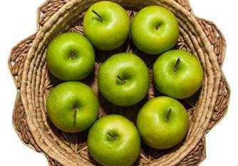 green apples in wicker basket