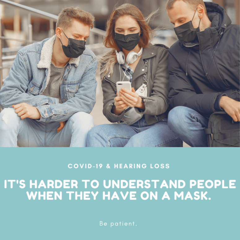 Three young adults wearing face masks and looking at one smart phone. Text of COVID 19 & Hearing loss. It's harder to understand people when they have on a mask.