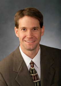 one man in brown suit with grey background