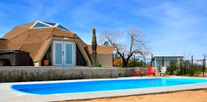 Dome house with pool and blue sky