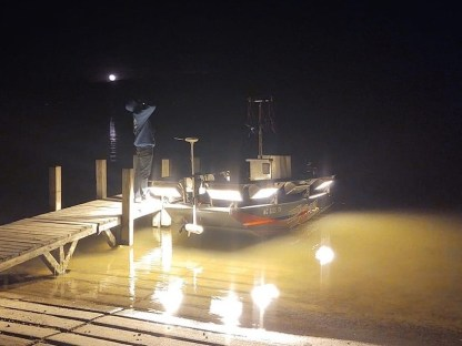 bowfishing boat with lights on at night