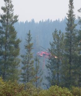 Helicopter picking up more water in Sugarpine Res.