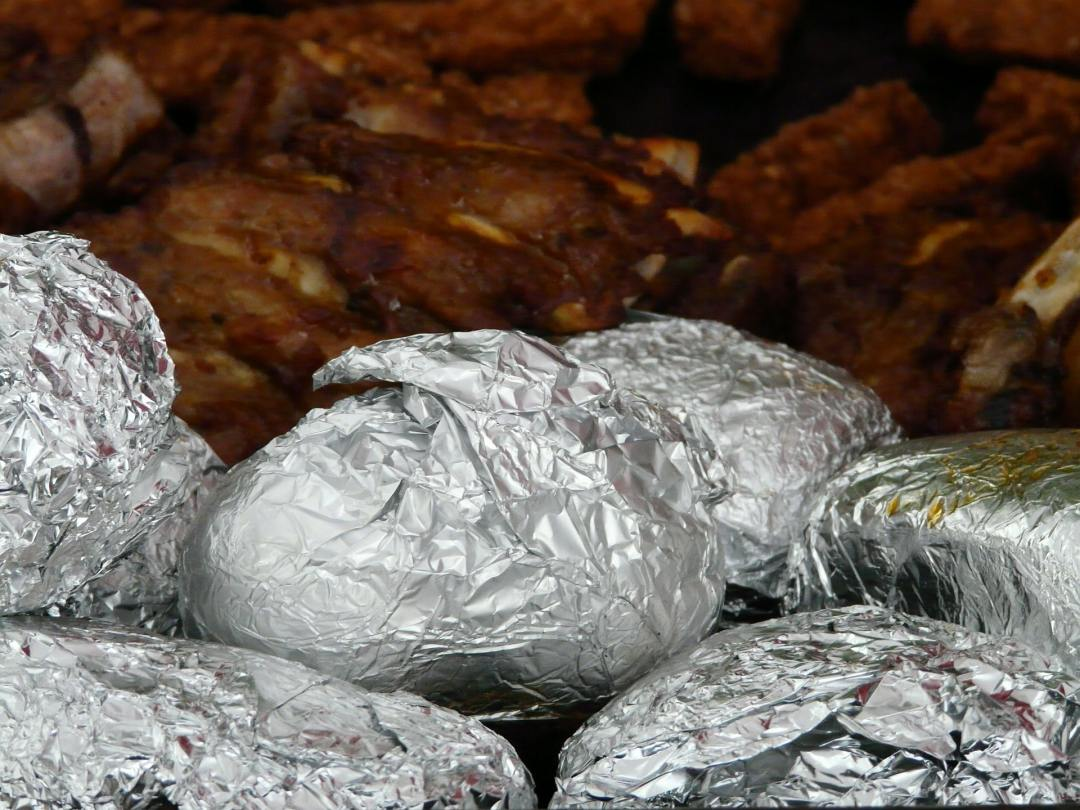 Best ever baked potatoes wrapped in foil and grilled