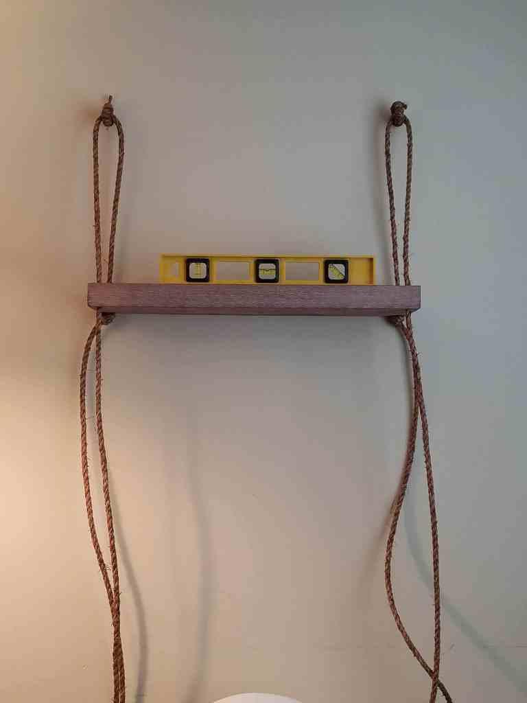 Easy DIY hanging shelf | make sure shelf is level