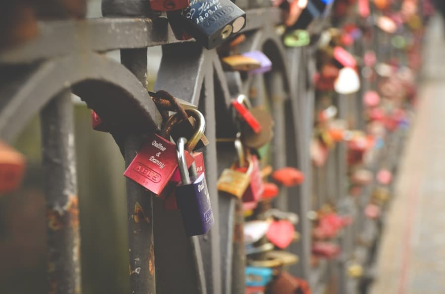 Place a love lock - place a lock on a bridge or fence