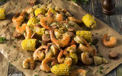 Image of Low country shrimp boil with shrimp, corn, potato and sausage