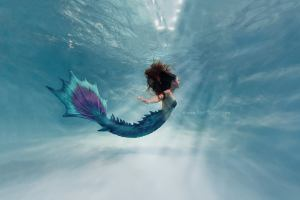 Mermaid Thalia in Open water by Ilse Moore