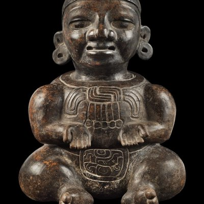 black effigy figure vessel front