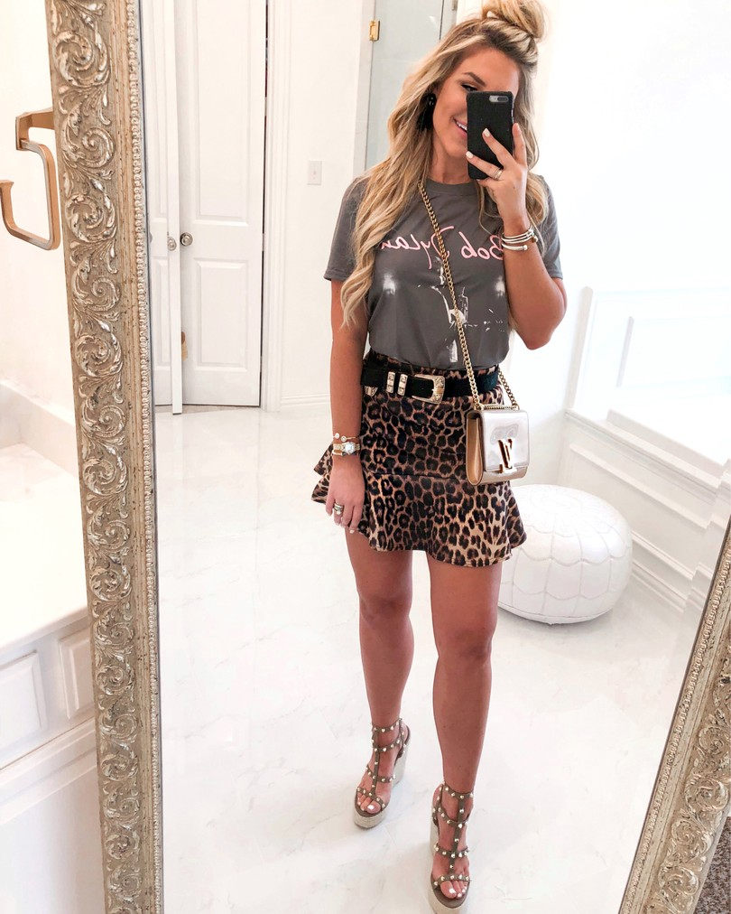 girl in concert tee and leopard skirt taking mirror selfie try on haul