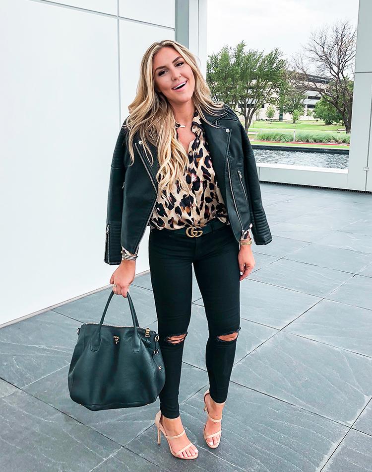 blond woman wearing leopard print Gucci belt Prada Purse Nordstrom jacket Moto jacket Abercrombie jeans