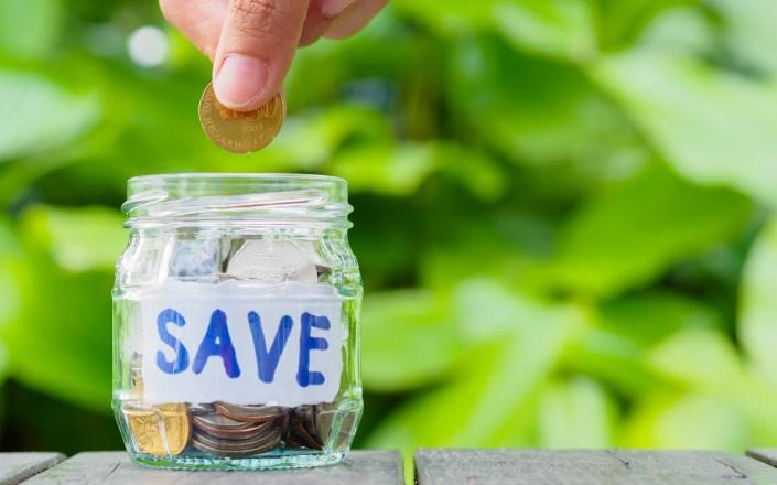 saving money challenge, personal finance, frugal living, saving money, abstract-money-saving-hand-hold-put-coin-glass-jar-coins, money challenges, save more money