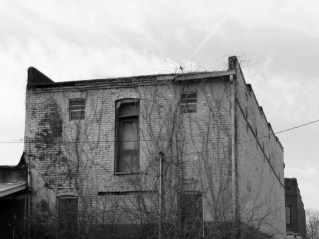 black and white photo of old brick building
