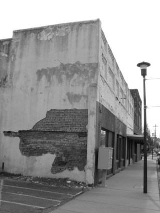 old downtown buildings with peeling plaster in black and white
