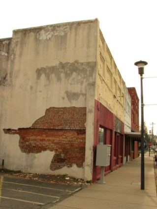 old downtown buildings with peeling plaster in color