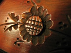 macro photo of flower carved into wooden dresser