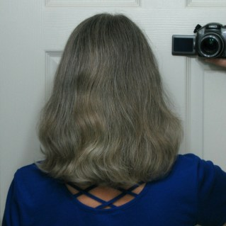 back of lady's head who washed hair yesterday with baking soda and vinegar