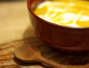 parangikkai soup in a bowl with coconut milk