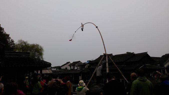 Acrobatics on a pole-boat.