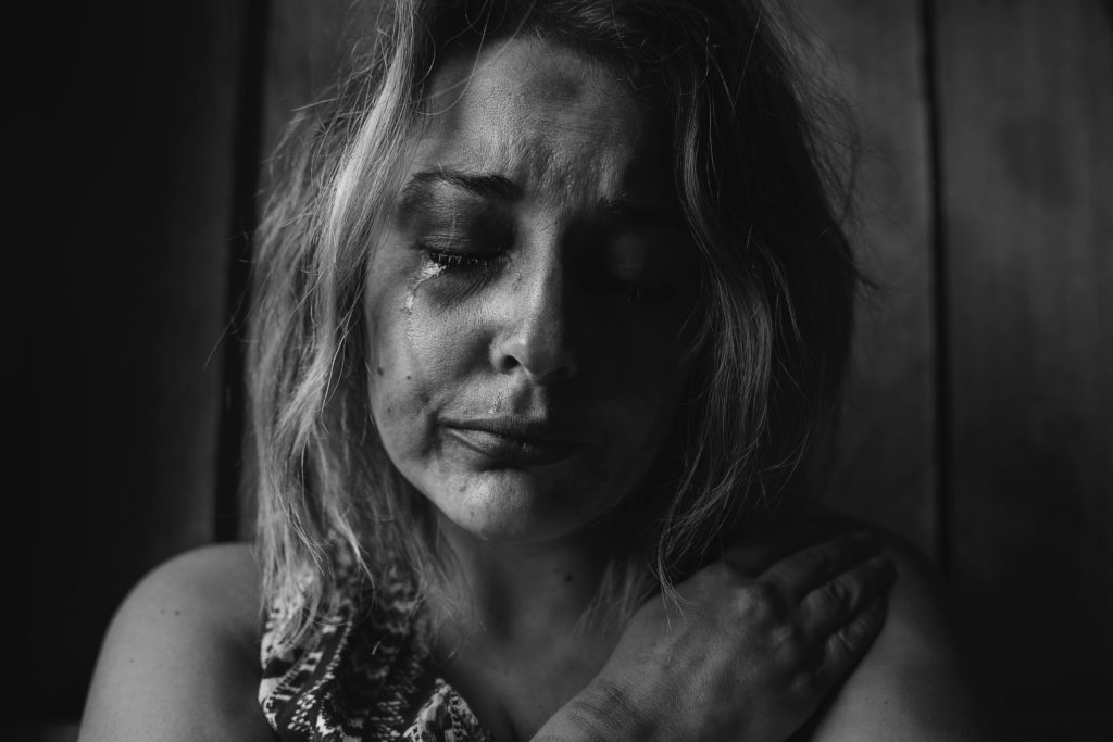 sex trafficking victim crying