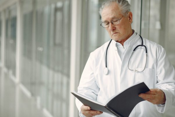 Doctor examines a case for a misdiagnosis lawyer
