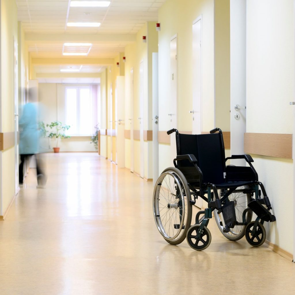 empty wheelchair representing deceased nursing home residents from nursing home negligence cases