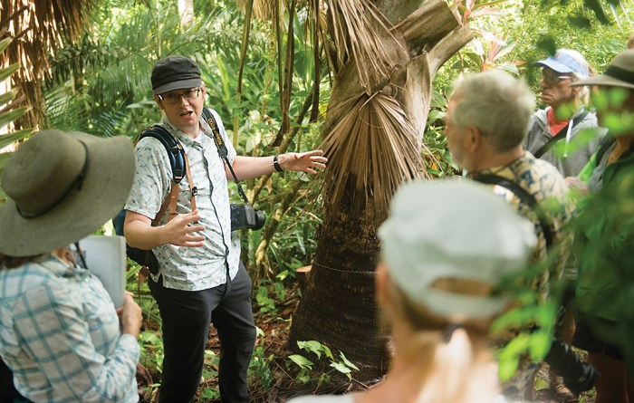 Bill Baker explaining what makes a palm a palm during a botany tour of the Merwin Palm Forest.