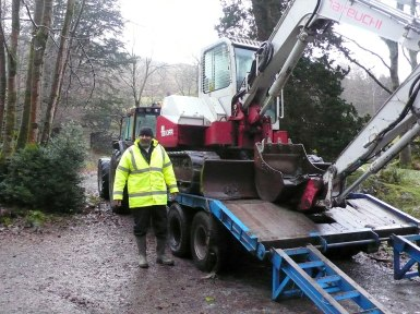 Contractor Mike Edmondson arriving to start work on the Merz Barn drainage system. Note the newness of his jacket and the digger!