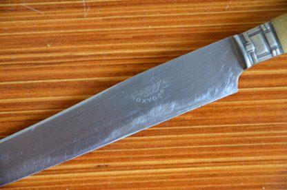 Lot de 5 couteaux vintage en inox et en plastique imitation corne.