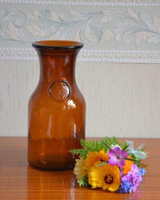 Bocal en verre couleur marron de la marque Dash sans son bouchon. Fabriqué en Belgique.