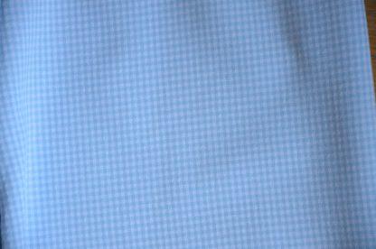 Pantalon cintré motif pied de poule bleu layette. Envie de séduire, Froggy, Paris. Se ferme par une fermeture éclair sur le coté. Non élastique.