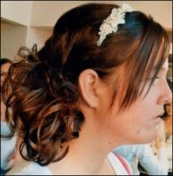 brunette bridesmaid up-do