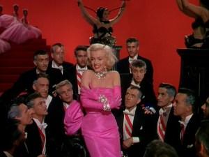 Screenshot of Marilyn Monroe from Gentlemen Prefer Blondes. A young Robert Fuller seen top right.